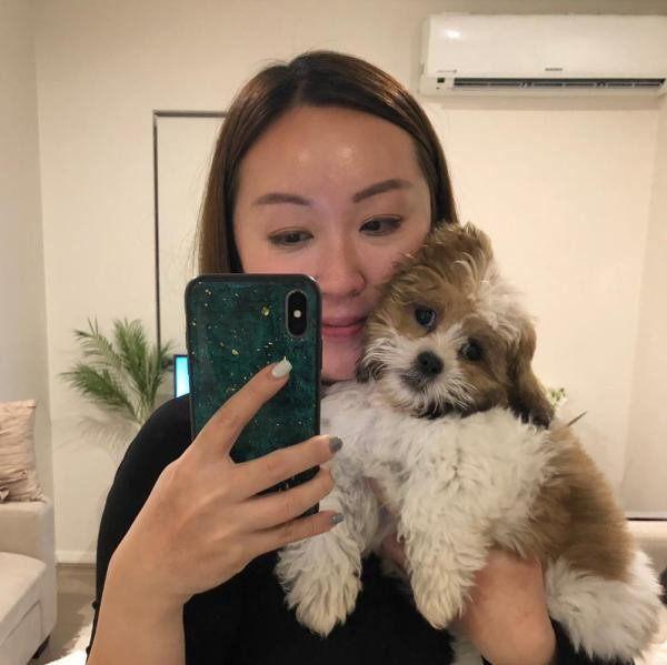 Xinny and her Pugalier at home in Singapore